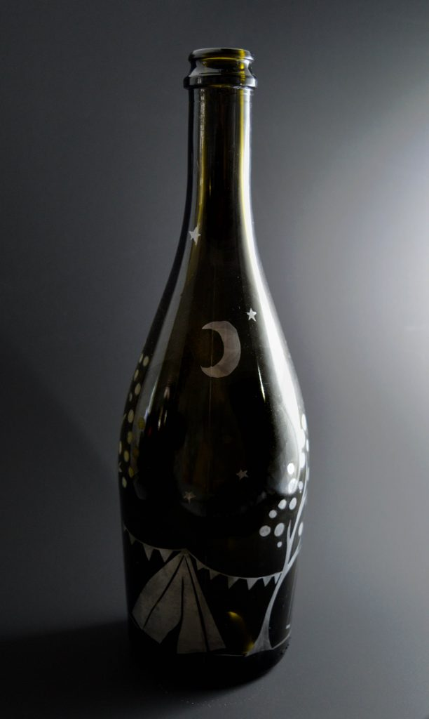 Etched champagne bottle